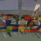 Photo n°1et n°2 : Le jeu de plateau «La course du Morphir». École publique de Labège /  Professeur: Annette Bion / Classe de CM2, moyenne d'âge: 10 ans / Labège. Prix de l'œuvre la plus ludique.
